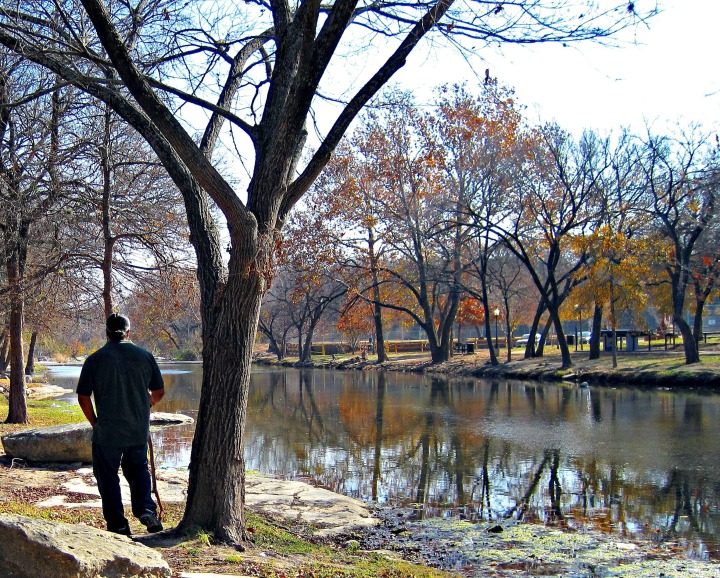 man-reflecting-by-the-water